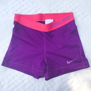 Purple Nike pros with pink band